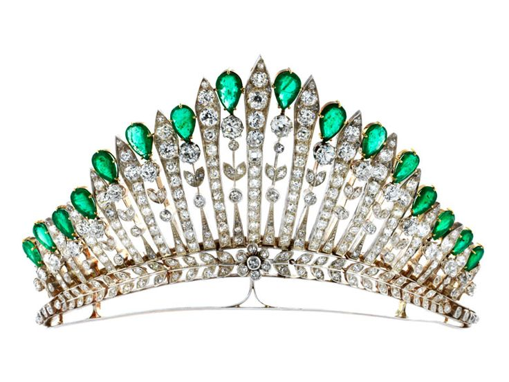 Antique diamond and emerald tiara Diameter: ca. 11 cm. Width at front: ca. 6.3 g. Weight: ca. 70.2 g. Silver on yellow gold. Ca. 1910.  Rare, magnificent tiara with fine, floral elements studded with old-cut diamonds, totalling ca. 18 ct, and fine drop-shaped, faceted emeralds, totalling ca. 14.5 ct. The diamond tiara could originally probably be worn as necklace, the emerald elements in between seem to have been added later. Small area of repair on the reverse.