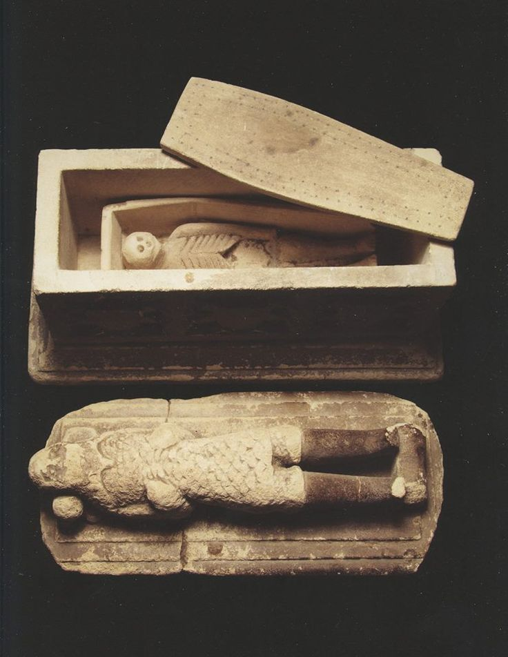 """"""" A Curious English Carved Limestone Model of a Medieval Knights Tomb: The Knight wearing mail lying on the lid which opens to reveal a coffin containing a carved stone skeleton, Early 19th Century. """"   Image from """"Camera Secreta: Auction catalogue from Finch & Co, 2014"""".  This book is part of the Morbid Anatomy Library Collection."""