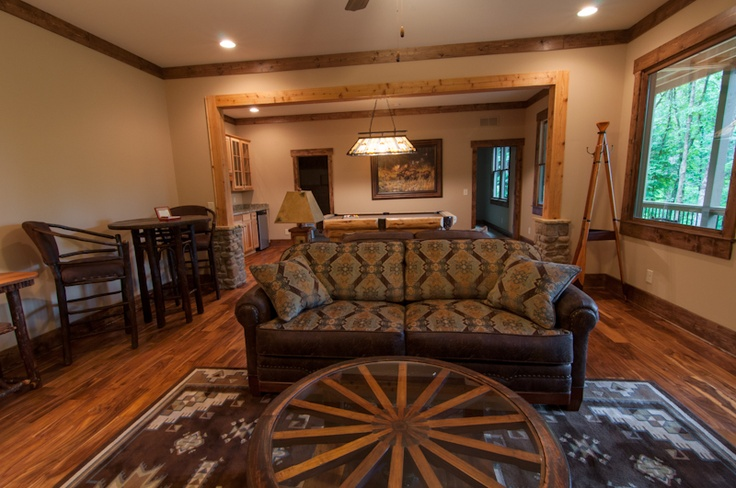 Wild West terrace level by Lakota Cove features wagon wheel coffee table and Southwestern sofa fabric combination.