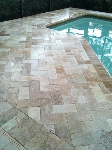 6x12 Roman Blend Travertine herringbone paver pool deck in New Tampa, Florida by Ceramictec