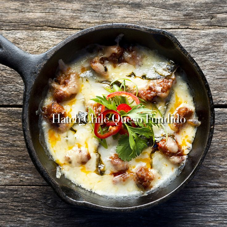 Hatch Chile Queso Fundido: delicious melted cheese with chorizo, onions and beer. Doesn't get much better than that!