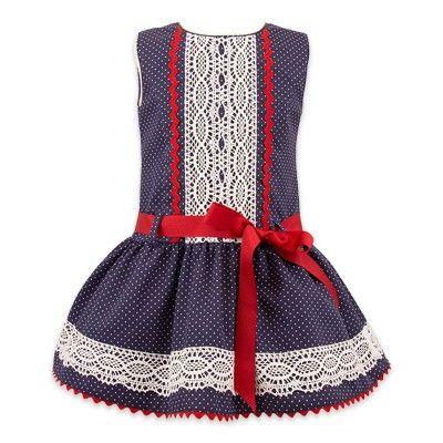 Vestido de niña marinero con talle bajo y lazo rojo y puntilla en la pechera…