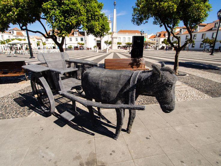 https://flic.kr/p/FnLTn7 | Marques de Pombal - Vila Real De Santo Antonio, Algarve Portugal | The former praca Real (Royal Square), now called Marques de Pombal Square, was a civic and commercial center during the Age of Enlightenment. It was delimited by the Council House and Jail (to the east), the Guard Corps (to the south) and the Church (to the North). The Square has the shape of an actual square, in which the radial has contrasting lines of the obelisk, defining it centrality.
