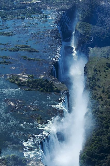 "Victoria Falls: A Natural Wonder of the World located on the border between Zambia and Zimbabwe, Africa. Also called Mosi-oa-Tunya--- meaning ""smoke that thunders."" Largest waterfall based on width and height--- one mile wide (1.7 km) and 360 feet high (108 meters)"