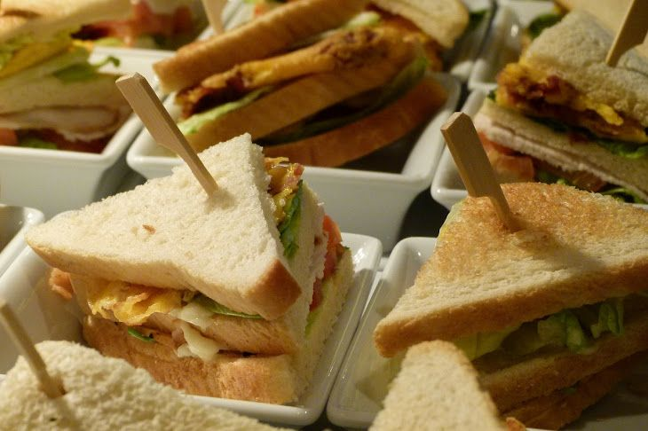 Chicken Club Sandwich Recipe Lunch and Snacks with white bread slices, sliced chicken, tomatoes, cheese slices, fried eggs, lettuce leaves, butter, mustard, mayonnaise