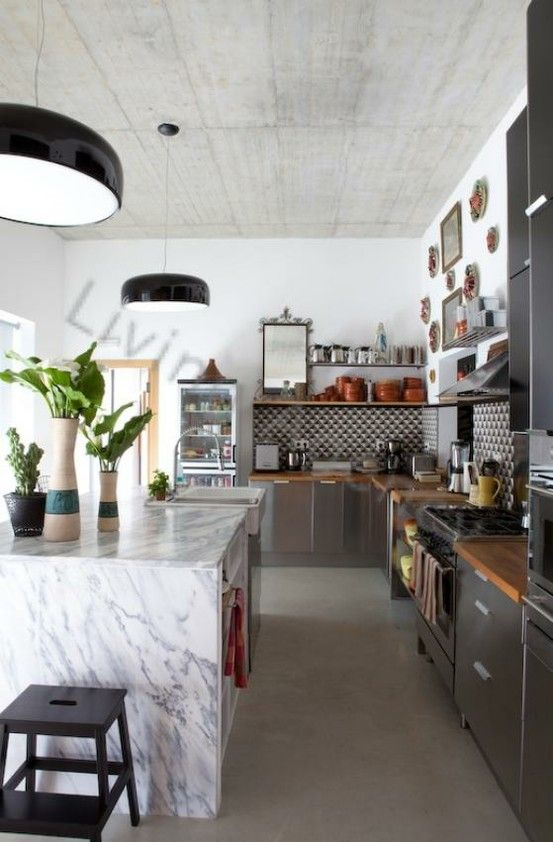 that marble counter and cement ceiling