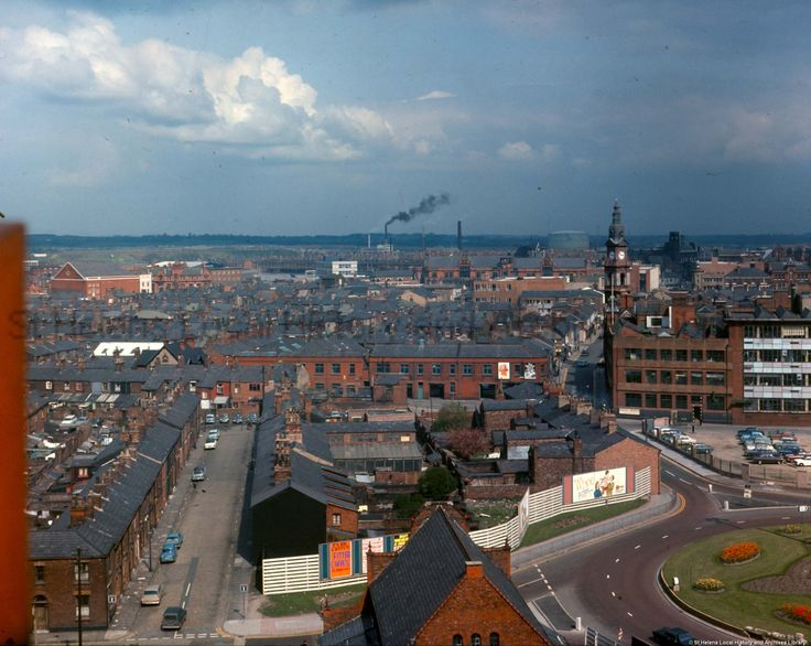A sunny day in St.Helens.c.1970. Looking up Westfield Street at Beecham's Pill's Clock Tower and the Town Hall beyond. Colour photographic transparency showing an aerial view over the Westfield Street area of St.Helens taken from the top of St Thomas's Church of England Church tower.Photographic transparencies of houses subject to Compulsory Purchase Orders in the Westfield Street, St.Helens area. ( Prior to the Asda Superstore being built over their footprint).