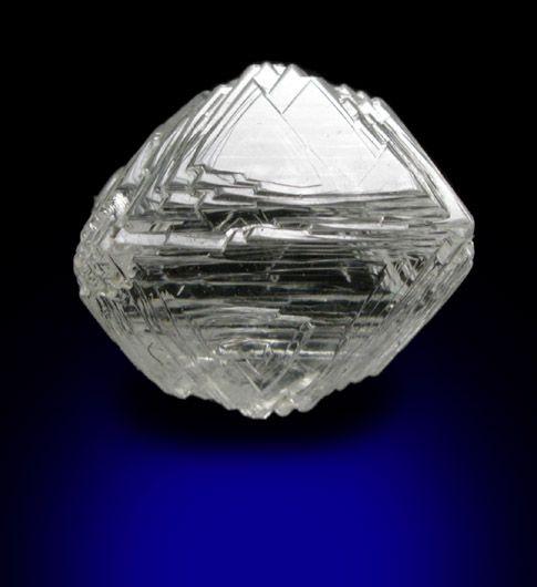 Diamond (1.92 carat cuttable gem-grade pale-yellow octahedral crystal) from Jericho Mine, Nunavut, Canada.