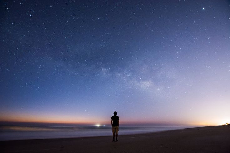 I photographed myself looking at the Milky Way just before sunrise over the Atlantic Ocean. : space