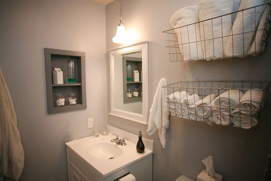 I love grey in all rooms.Small Bathroom, Guest Bathroom, Bathroom Storage, Bathroom Wall, Towels Storage, Bathroom Ideas, Wire Baskets, Towel Storage, Storage Ideas