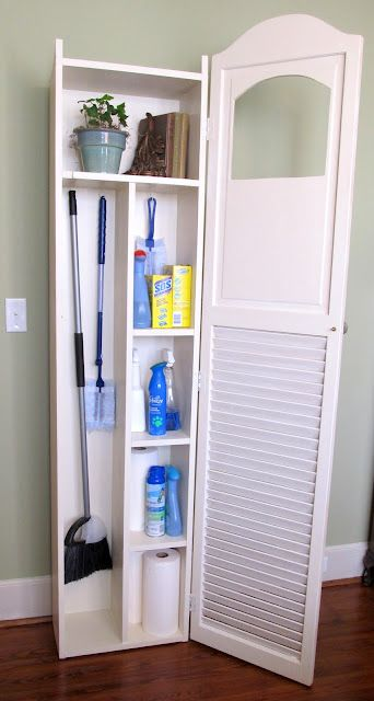 "$15 bi-fold louvered doors;took one of the doors and flipped it upside down. Using a jigsaw, I cut the decorative top edge and the little ""peek-a-boo"" hole. The cabinet body was made from 1x10's and the shelves were arranged to accommodate all my cleaning supplies.A few pieces of scrap wood trim and a plastic Goodwill doo-dad to jazz it up a bit. (maybe I could do this too???)"