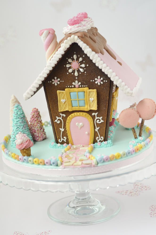 Love the macaron trees and the marshmallow twist chimney on this gingerbread house.