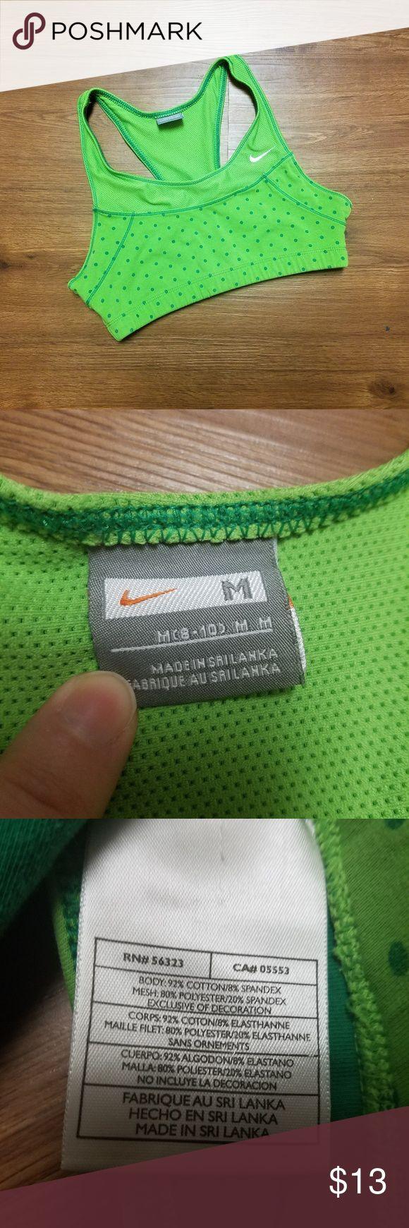 Nike green polka dot sports bra (M) Nike green polka dot sports bra. Women's size medium. Very stretchy. Nike Intimates & Sleepwear Bras
