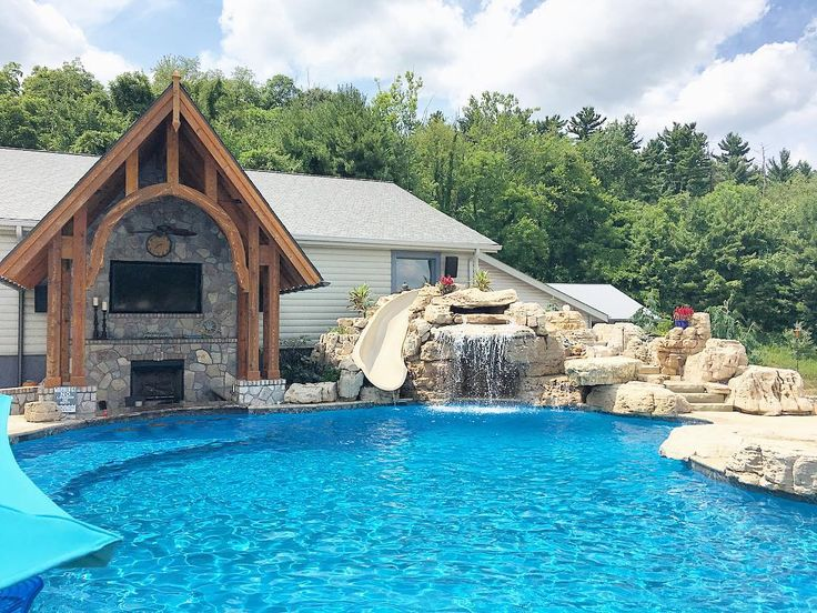what a backyard pool waterfall slide fireplace and tv