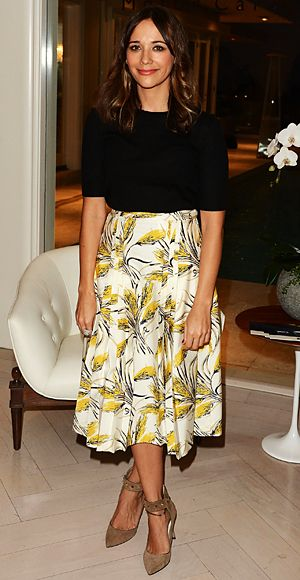 A Midi Skirt  The Look: A full skirt goes pro with the right pairings.  The Key: The mid-calf length is ideal for more conservative settings; add a slim blouse or blazer to balance out the volume down below.