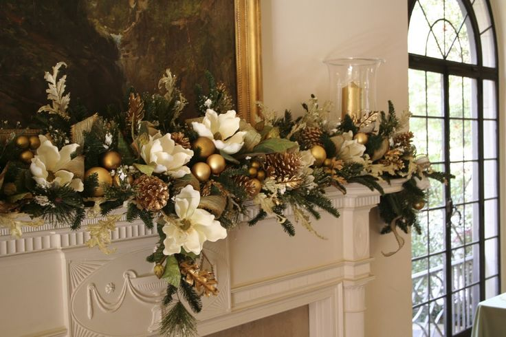 faux christmas magnolia leaf garland | We anchored each side of the mantle with glass hurricanes and gold ...