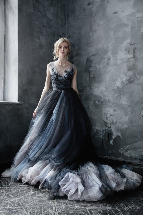 Dramatic grey wedding dress featuring layers of tulle and an embroidered bodice