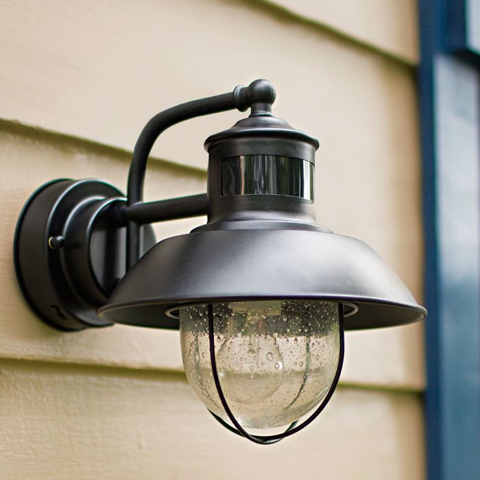 Motion-activated outdoor wall lights are practical, energy-efficient, and add an aesthetic touch to the doorway.