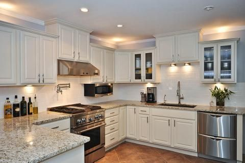 Traditional Kitchen with stainless steel two drawer dishwasher