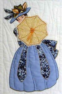 Phoebie with fancy applique hat and umbrella