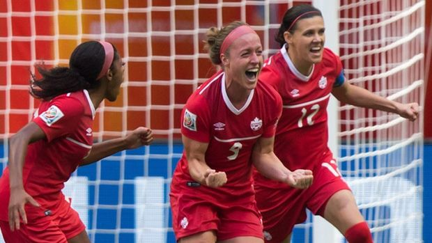 "Canada's Christina Sinclair, right, has made those around her better at the Women's World Cup , says coach John Herdman. The 32-year-old forward from Burnaby, B.C., has drawn criticism from some quarters for her play but Herdman says Sinclair is ""a world-class person, world-class player. She gives everything to this team every single game."""