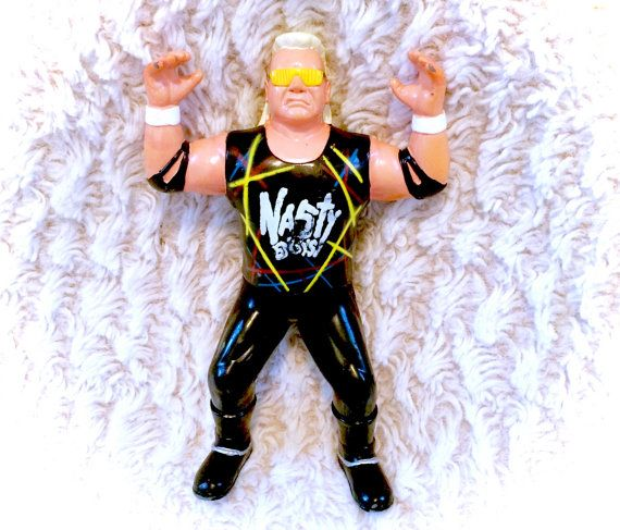 A good condition 1994 WCW wrestling action figure of Brian Knobbs of the Nasty Boys! Please see all pictures up close for a thorough representation! :) I have TONS more vintage items in my Etsy store!  I ship WORLDWIDE from a clean, pet & smoke-free home! Please note that shipping times will be slower OUTSIDE of the US & Canada (up to 3 months in some cases), and tracking is not included to those locations. I offer VERY cheap combined shipping rates, so be sure to check out my other items to…