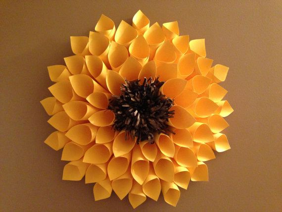 Fun day paper flower idea. 2 rows of flattened petals, orange pieces then brown loop center. Got it. Now to do it.
