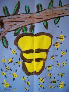 * Verf de tak en de korf daarna met een vingertop de bijtjes erbij maken!