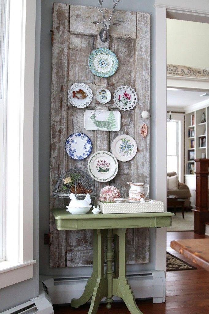 Vintage Door Plate Wall - A different approach to a plate wall - do it on a vintage door hung on the wall. Perfect in a corner in any room, especially a dining room or kitchen.