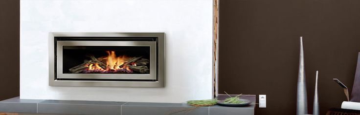 REGENCY Greenfire GF900L Gas Fireplace: Large Regency Gas Fireplace - The Regency Greenfire™ adds modern expression to any living space with today's sleek, linear styling. This series features seamless design and beautiful wide angle flames set on a coastal driftwood log fire. Efficient, clean-burning zone heating has never been more stylish! #Heating #Gas #Inbuilt #Regency #HearthHouse
