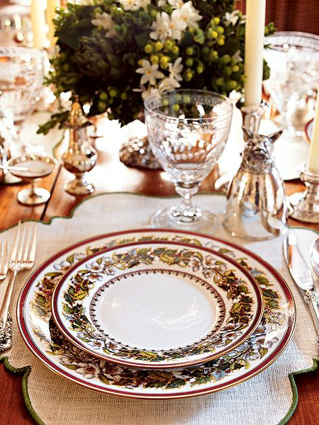 Blossom-shaped place mats and Christmas china freshen a setting for the season. (Photo: Rick Lew)