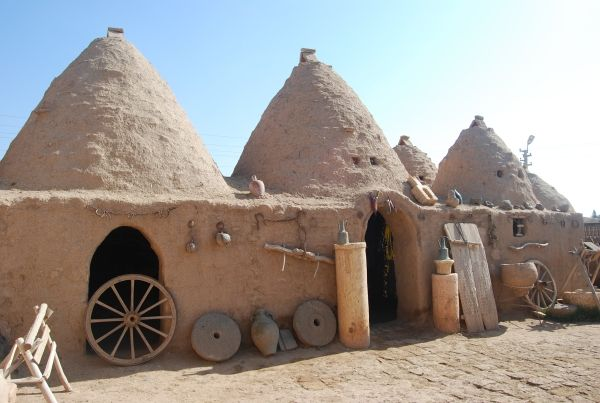 *TURKEY ~ Harran beehive houses (domes) are connected by arched passageways to form one big house around a courtyard.