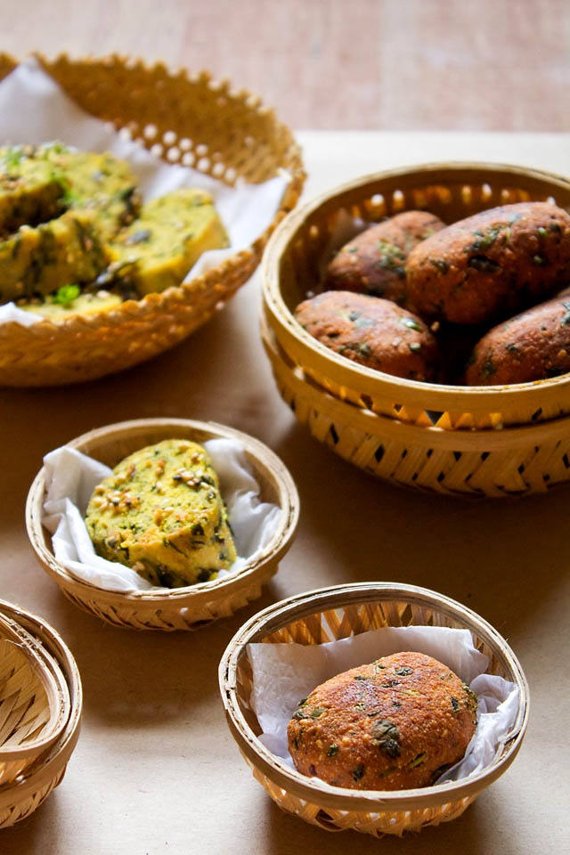 an awesome snack from the western state of gujarat in india - steamed and fried methi muthia (chickpea flour and fenugreek leaves dumplings) - step by step recipe...