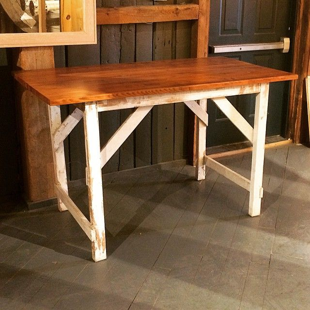 This table has a top made from reclaimed Douglas Fir Glu-Lam on a reclaimed work bench base with its original white paint. It's size is perfect as a desk, island, or small dining table! #reclaimed #interiordesign #rusticdesign