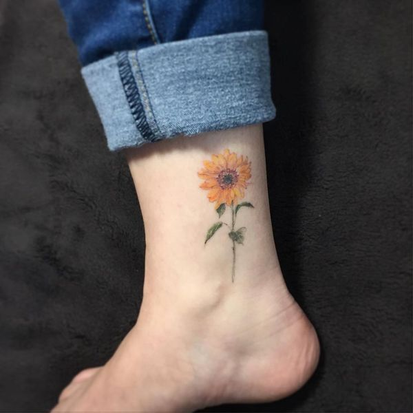 22 The small sunflower tattoo on the ankle