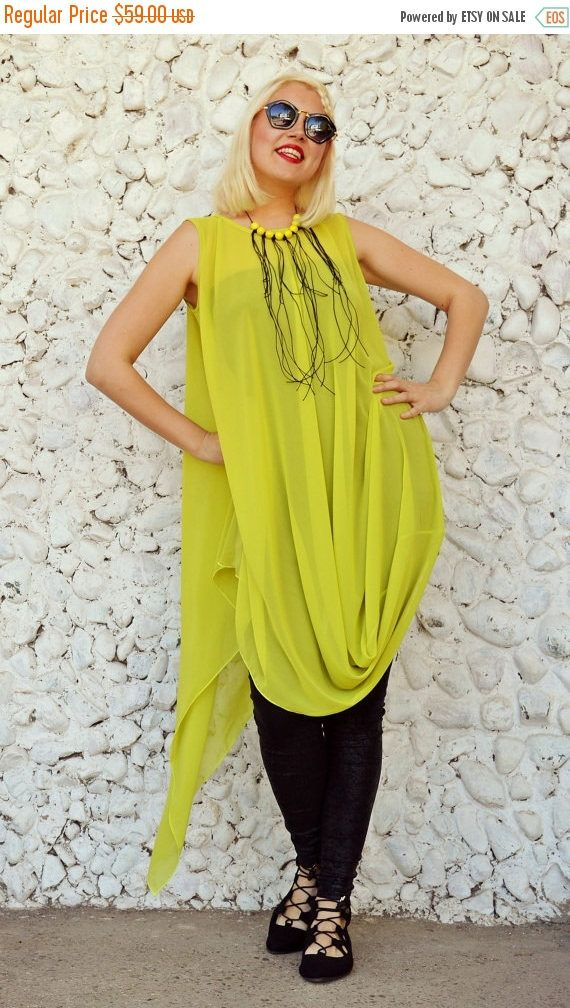 Funky long summer top made of the finest chiffon, very loose and soft, being extremely comfortable and fun to wear. The powerful sunny mustard will for sure brighten up the streets this summer!  This piece comes with an underneath viscose black top. Two products for this item! Material: mustard top - 100% Chiffon underneath black top - 95% Viscose, 5% Elastane Care instructions: Wash at 30 degrees  The model in the picture is size S.  Can be made in ALL SIZES.  If you have any other specific…