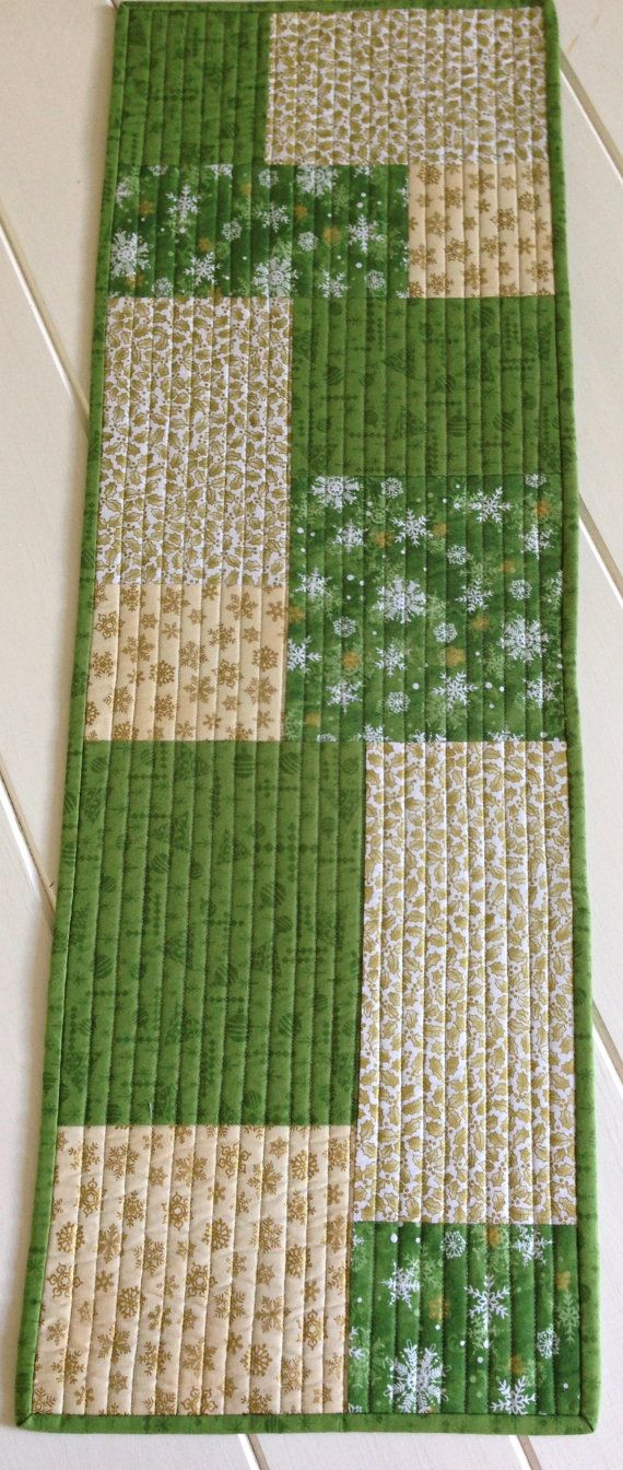 Quilted Christmas Table Runner, Holiday Table Cloth for table or side board or bedroom dresser, Quiltsy Handmade  Quilted Christmas Table Runner is made with Christmas fabrics in green and gold. Finished size is approximately 12 X 36. All my products are made with quality quilting cotton fabric. All products are made in a smoke-free, pet-free environment. Easy care - Gently wash in cold water; tumble dry on low. If necessary, press lightly with iron.  If you would like to see my other table…