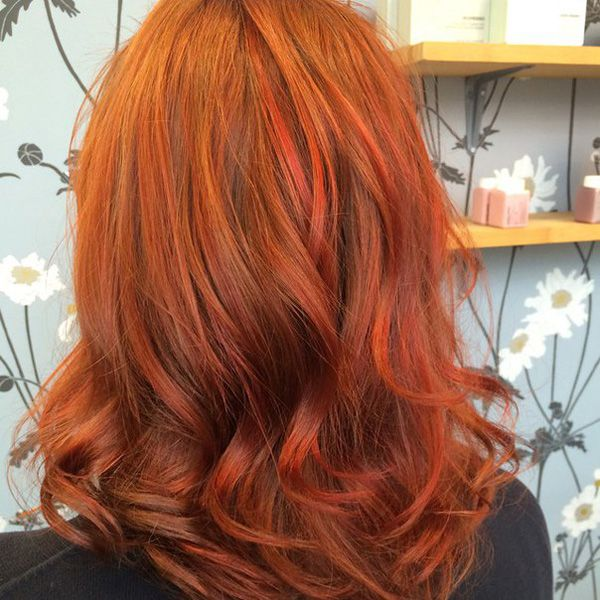 auburn and red hairstyle with loose waves