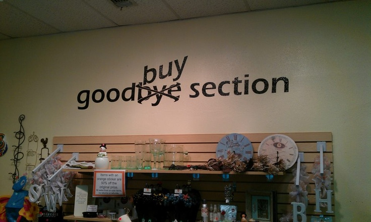 Clearance section of Peaches Home and Gifts in San Antonio TX.   Remembering that any great display store area can also convert to a great show display idea... this would be cute on a sign for a sale area at a booth. Love the sign, super cute!!