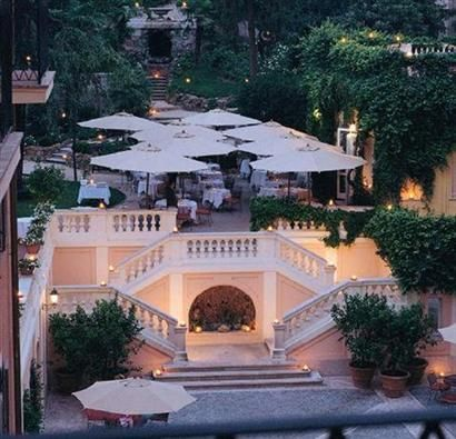 Rome, Italy: Hotel de Russie, courtyard, steps lead back to the Borghese gardens though there is no access from the hotel.
