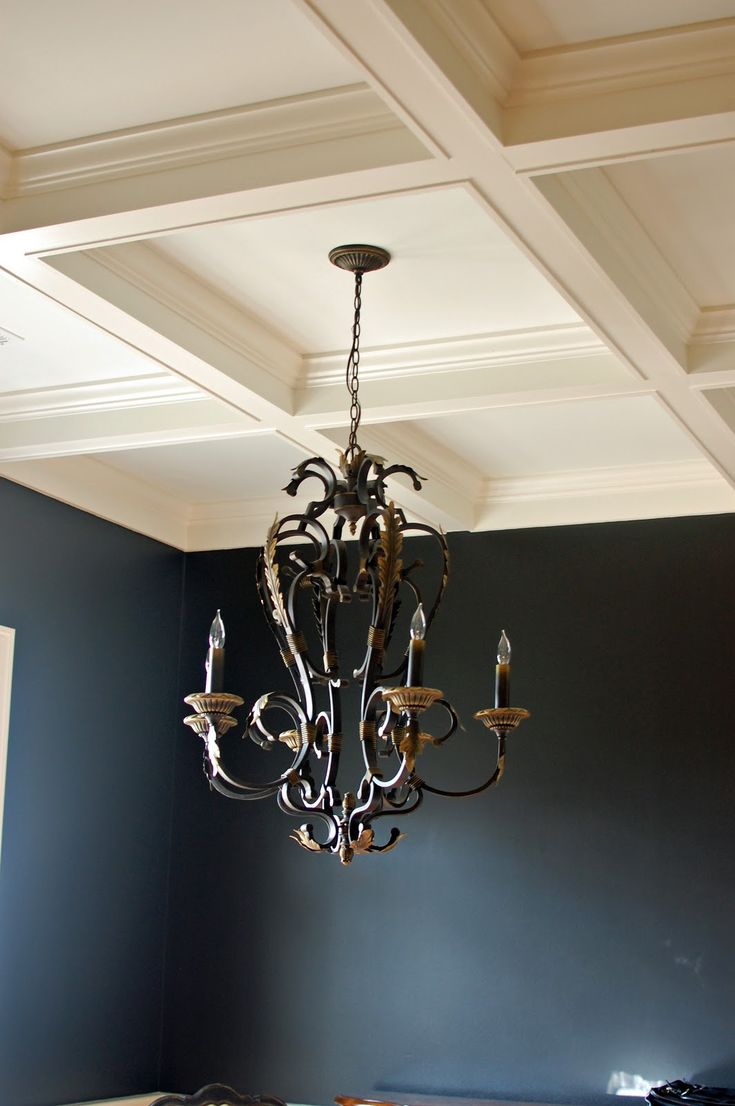 Black dining room with coffered ceilings. Love:)