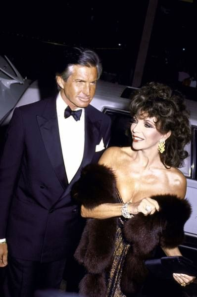 Joan Collins escorted by George Hamilton