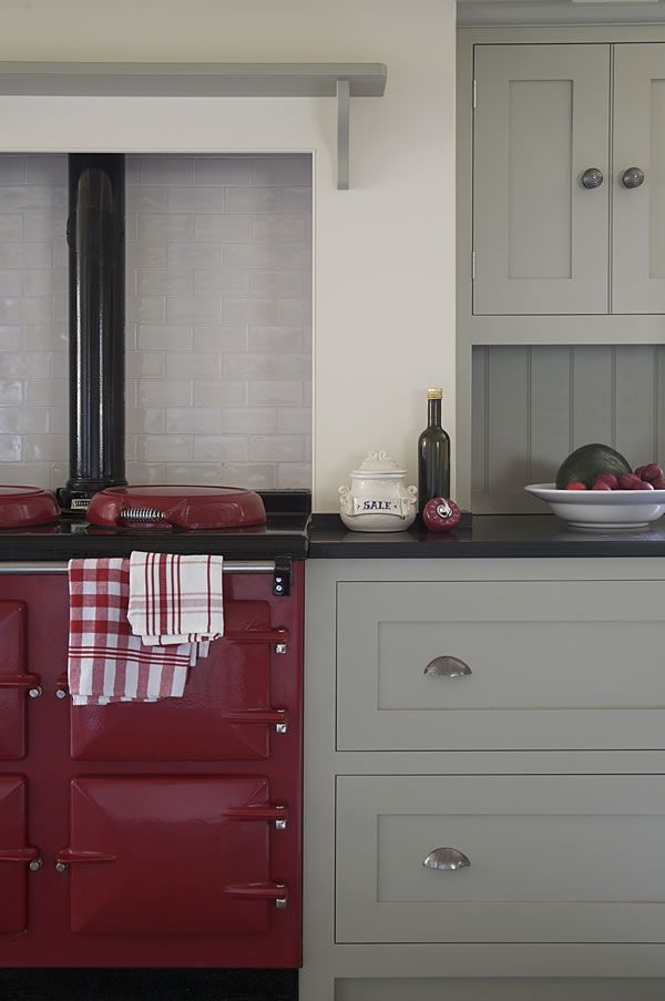 Country kitchen w/ red AGA cooker; cabinets by Landmark