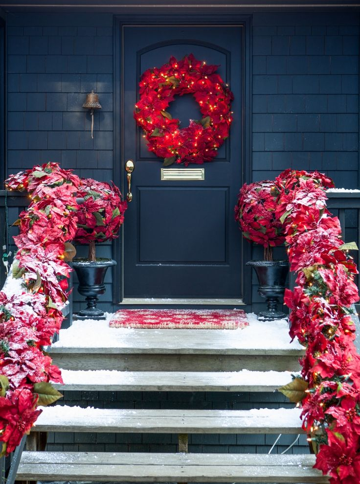 Dress up your home for the season with our stunning Outdoor LED Poinsettia  Topiary.