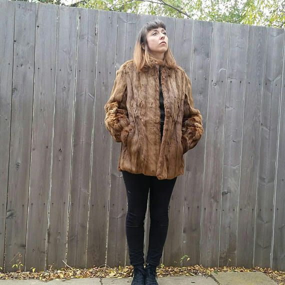 Check out this item in my Etsy shop https://www.etsy.com/listing/563670961/vintage-1980s-marmot-fur-short-coat-with