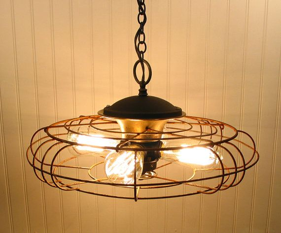 Pendant light repurposed from vintage fan.  so cool
