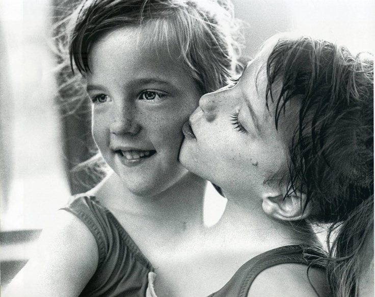 I believe this is a portrait of conjoined twins Abigail and Brittany Hensel...They are in their 20's now and still the most adorable of girls, watching them navigate their own space and that around them is amazing as they each control one side of their body yet work in magnificent unison/cooperation.