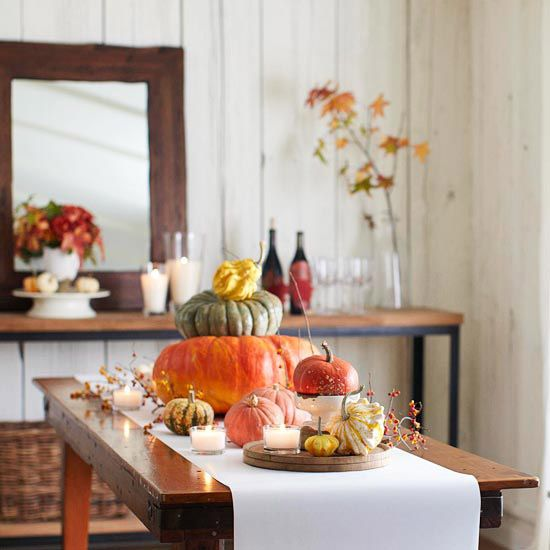 No pumpkin is too small or too big for a stackable centerpiece. (Bonus points for colorful gourds.) See more of our favorite fall centerpieces.