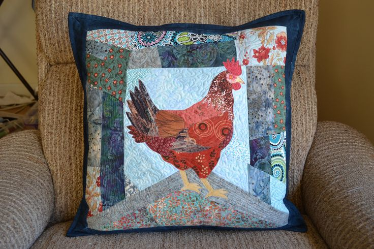 This is my first attempt at raw edge applique and FMQ.  I was inspired by Ruth McDowell and others.  I made this for my chook loving sister in law.