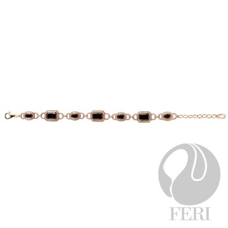 """- Exclusive 950 fine sterling silver - Exclusive 3 micron rose gold plating - Set with AAA white cubic zirconia and a rich mahogany colored cubic zirconia - Length: 6.5"""" + 1.75"""" extender with lobster clasp"""